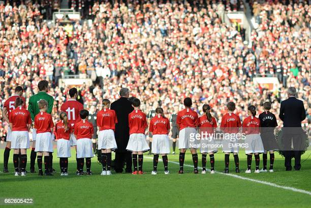 Manchester United mascots wearing shirts bearing the names of those who lost their lives in the Munich air disaster