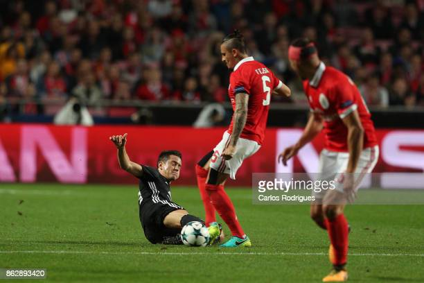 Manchester United midfielder Ander Herrera from Spain vies with Benfica's midfielder Ljubomir Fejsa from Serbia for the ball possession during SL...