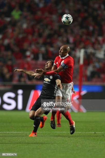 Manchester United midfielder Henrikh Mkhitaryan from Armenia tries to escape Benfica's defender Luisao from Brasil during SL Benfica v Manchester...