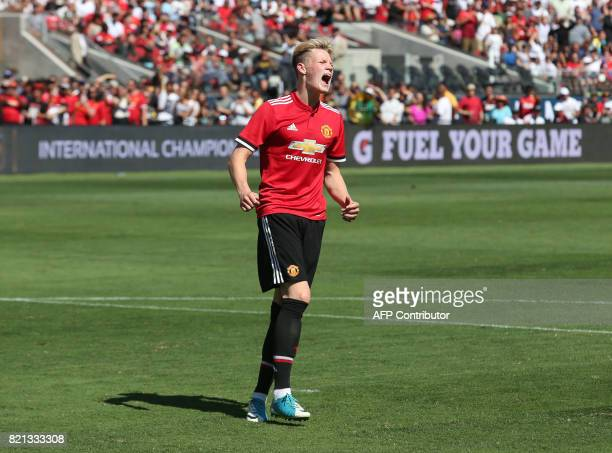 Manchester United midfielder Scott McTominay reacts after missing a penalty kick shootout against Real Madrid in the International Champions Cup...