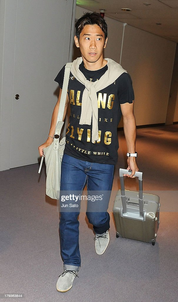 Manchester United midfielder <a gi-track='captionPersonalityLinkClicked' href=/galleries/search?phrase=Shinji+Kagawa&family=editorial&specificpeople=4314029 ng-click='$event.stopPropagation()'>Shinji Kagawa</a> is seen upon airport arrival on September 2, 2013 in Tokyo, Japan.