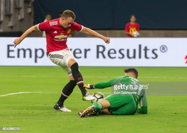 Manchester United Phil Jones attempts to chip the ball over Manchester City goalkeeper Ederson Moraes during the International Champions Cup match...