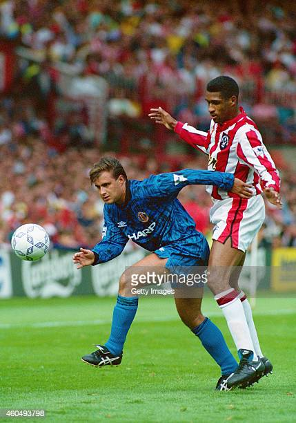 Manchester United player Clayton Blackmore holds off Sheffield United striker Brian Deane during the first round of FA Premier League games at...