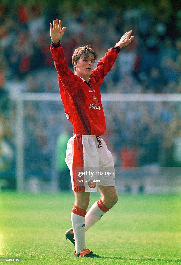 Manchester United player David Beckham celebrates after scoring the third goal with a spectacular effort from the halfway line, during the Premier League match between Wimbledon and Manchester United at Selhurst Park on August 17, 1996 in London, England.