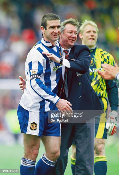 Manchester United player Eric Cantona and manager Alex Ferguson celebrate after Manchester United claim the title after the FA Premier League match...