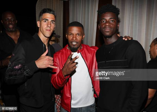 Manchester United player Joel Castro Pereira actor Jamie Foxx and Manchester United player Axel Tuanzebe attend Adidas and The Manchester United...