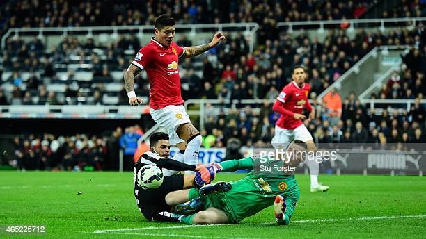 Manchester United player Marcos Rojo and goalkeeper David De Gea combine to deny Emmanuel Riviere of Newcastle during the Barclays Premier League...