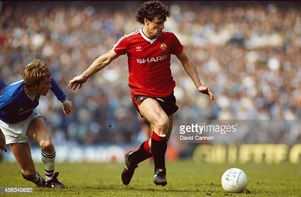 Manchester United player Mark Hughes beats Alan Harper of Everton to the ball during a League Division One match between Everton and Manchester...