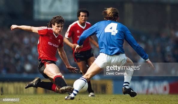 Manchester United player Mark Hughes challenges Everton player Alan Harper as Remi Moses looks on during a League Division One match between Everton...