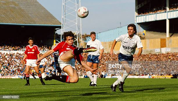 Manchester United player Mark Hughes in action watched by spurs players Paul Gascoigne and Terry Fenwick during a league division One match between...