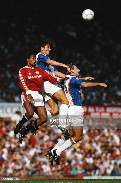 Manchester United player Paul Ince challenges Luton players Mick Harford and John Dreyer during a League Division One match between Manchester United...
