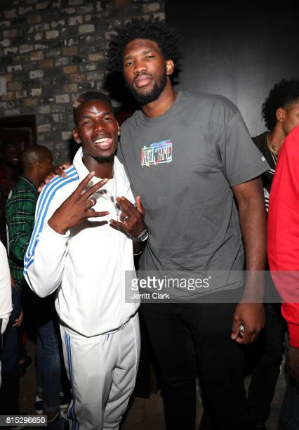 Manchester United player Paul Pogba and NBA player Joel Embiid attend Adidas and The Manchester United Squad present Unmissable featuring a live...