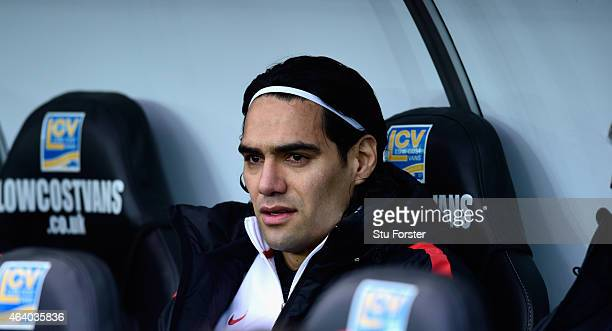 Manchester United player Radamel Falcao looks on from the substitutes bench before the Barclays Premier League match between Swansea City and...