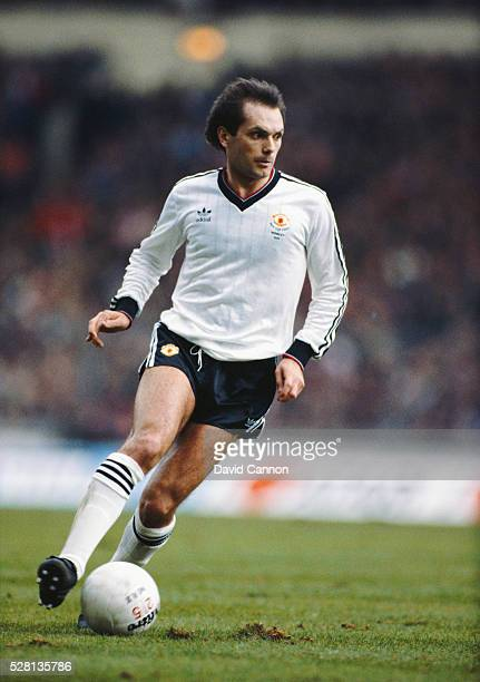Manchester United player Ray Wilkins in action during the 1983 Milk Cup Final against Liverpool at Wembley Stadium on March 26 1983 in London England...