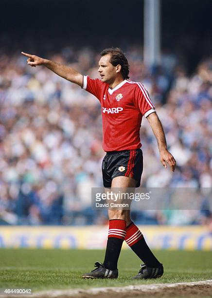 Manchester United player Ray Wilkins reacts during a League Division One match against Everton at Goodison Park on May 5 1984 in Liverpool England