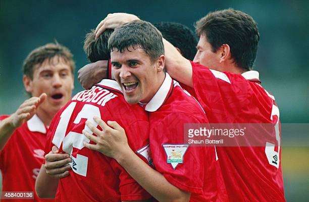 Manchester United player Roy Keane celebrates a goal by Bryan Robson with team mates during a Premier League match between Norwich City and...