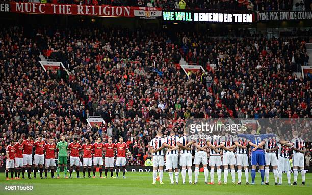 Manchester UNited players and West Bromwich Albion players pause for a minute's sillence in honour of Remebance Sunday ahead of the English Premier...
