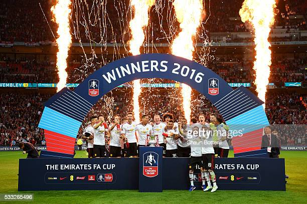 Manchester United players celebrate victory with the trophy after The Emirates FA Cup Final match between Manchester United and Crystal Palace at...
