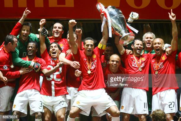Manchester United players celebrate with the trophy following their team's victory during the UEFA Champions League Final match between Manchester...