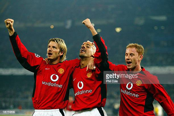 Manchester United players David Beckham Juan Sebastian Veron and Nicky Butt celebrate during the UEFA Champions League Second Phase Group D match...