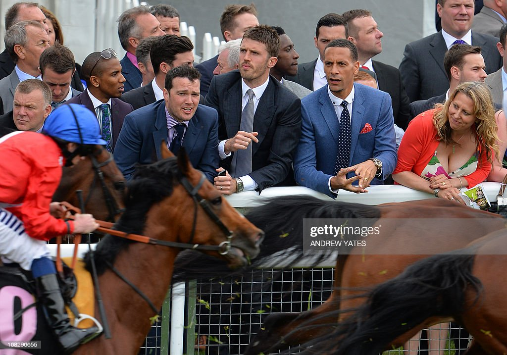 Manchester United players, English midfielder Michael Carrick (C), English striker Danny Welbeck (C back), English defender Rio Ferdinand (2R) and English midfielder Ashley Young (2L) watch the Chester Races horse racing event at Chester Racecourse in Cheshire, northwest England on May 8, 2013. Alex Ferguson will retire as Manchester United boss at the end of the season, the Premier League champions announced on May 8, ending the most successful managerial reign in English football.