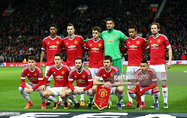 Manchester United players line up for the team photos prior to the UEFA Europa League Round of 32 second leg match between Manchester United and FC...