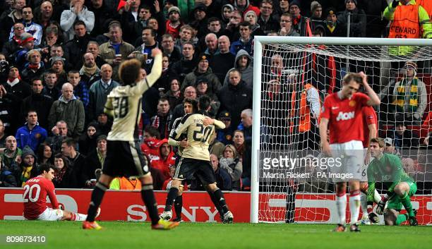 Manchester United players look dejected as Benfica's Pablo Aimar celebrates scoring his side's second goal of the game