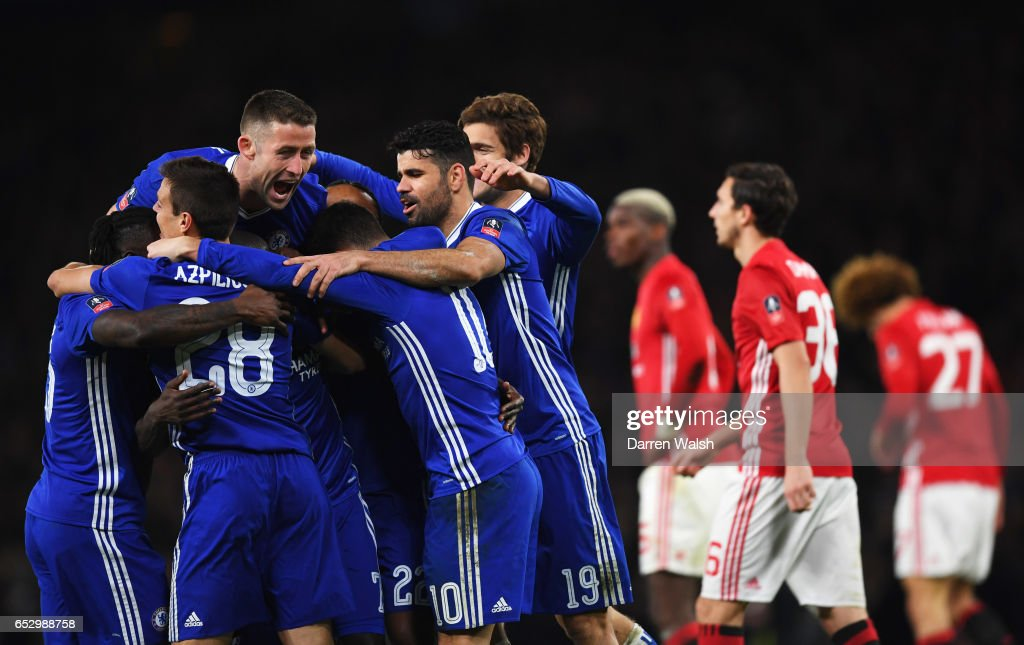 Manchester United players look dejected as N'Golo Kante of Chelsea (obscured) celebrates as he scores their first goal with team mates during The Emirates FA Cup Quarter-Final match between Chelsea and Manchester United at Stamford Bridge on March 13, 2017 in London, England.