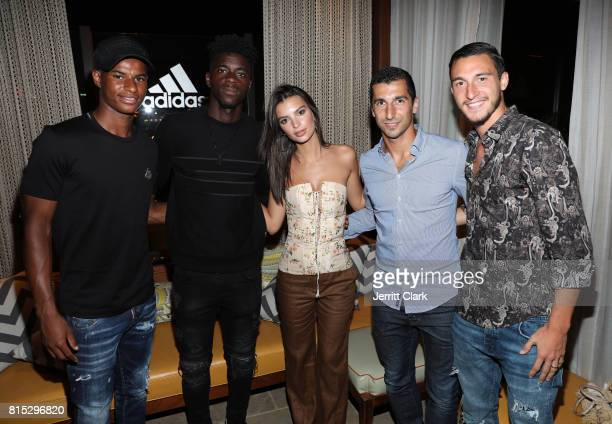 Manchester United players Marcus Rashford Axel Tuanzebe model Emily Ratajkowski and Manchester United players Henrikh Mkhitaryan and Matteo Darmian...