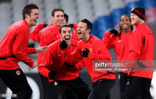 Manchester United players Michael Carrick John O'Shea Ryan Giggs and Wayne Rooney during a training at the Stade Gerland in Lyon France
