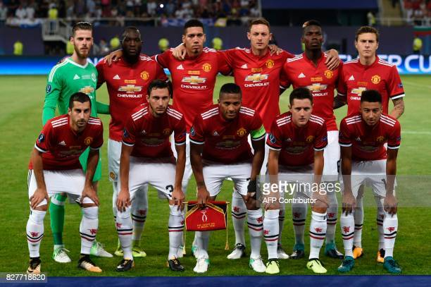 Manchester United players pose for a photograph prior to the UEFA Super Cup football match between Real Madrid and Manchester United on August 8 at...