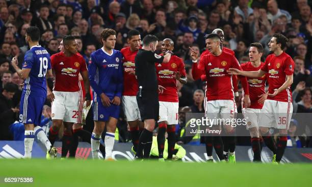 Manchester United players protest as Ander Herrera of Manchester United is shown a red card by referee Michael Oliver and is sent off during The...