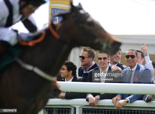 Manchester United players Robin van Persie and Rio Ferdinand cheer home a winner at Chester racecourse on May 08 2013 in Chester England
