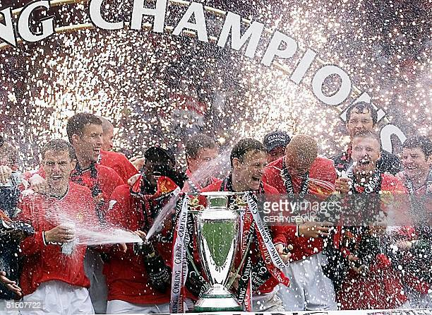 Manchester United players spray champagne as fireworks explode after they won the Premiership Cup 05 May 2001 Manchester United won the league title...