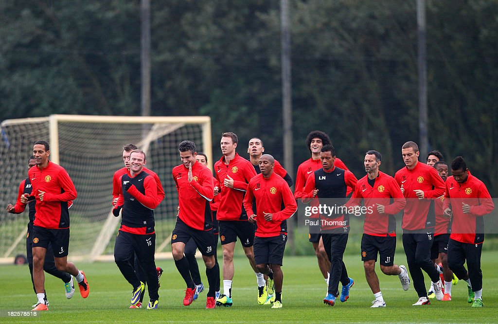 Manchester United players warm up during a training session ahead of their Champions League Group A match against Shakhtar Donetsk at their Carrington Training Complex on October 01, 2013 in Manchester, England