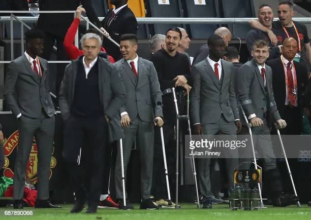 Manchester United players watch on from the sidelines during the UEFA Europa League Final between Ajax and Manchester United at Friends Arena on May...