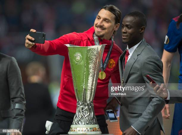 Manchester United players Zlatan Ibrahimovic and Eric Bailly pose with the trophy after winning the Europa League Final between Manchester United and...