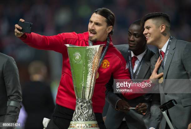 Manchester United players Zlatan Ibrahimovic Eric Bailly and Marcos Rojo pose with the trophy after winning the Europa League Final between...