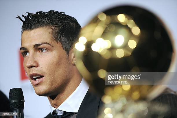 Manchester United Portuguese winger Cristiano Ronaldo answers to journalists' questions next to his trophy after he received the European footballer...