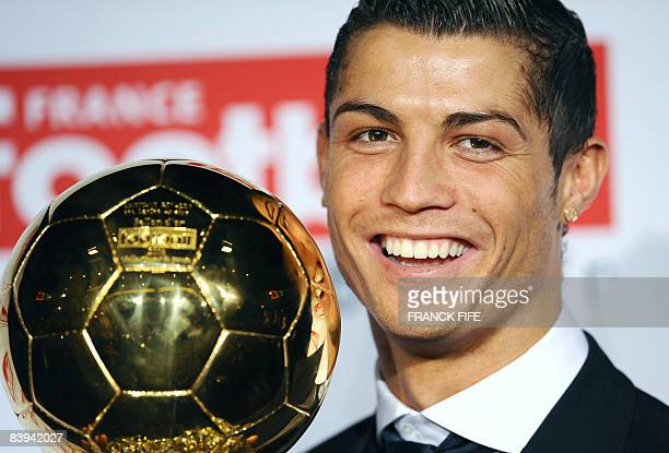 Manchester United Portuguese winger Cristiano Ronaldo poses with his trophy after he received the European footballer of the year award the 'Ballon...