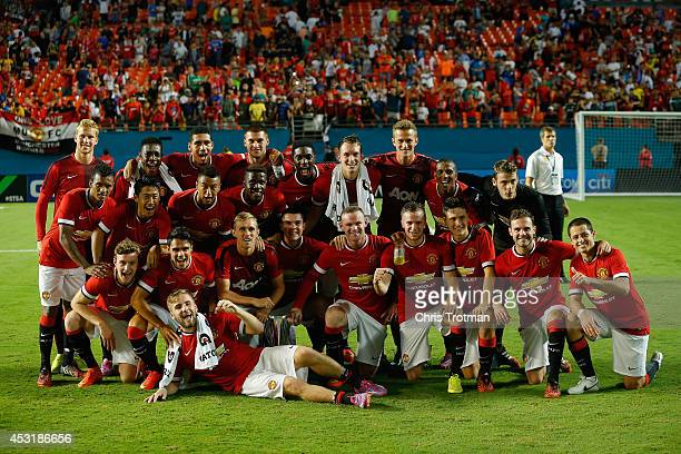 Manchester United pose for a photograph following their victory over Liverpool in the Guinness International Champions Cup 2014 Final at Sun Life...