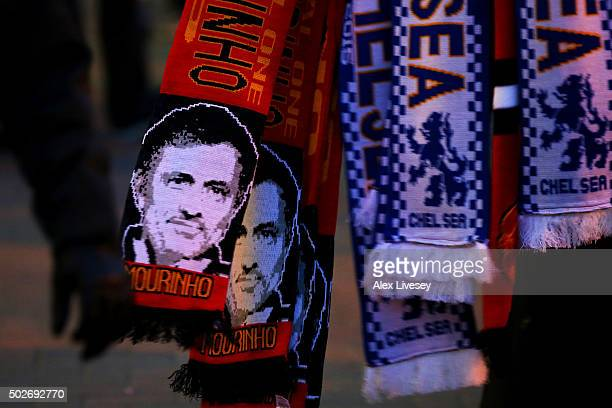 Manchester United scarves displaying the image of former Chelsea manager Jose Mourinho are sold outside the stadium before the Barclays Premier...