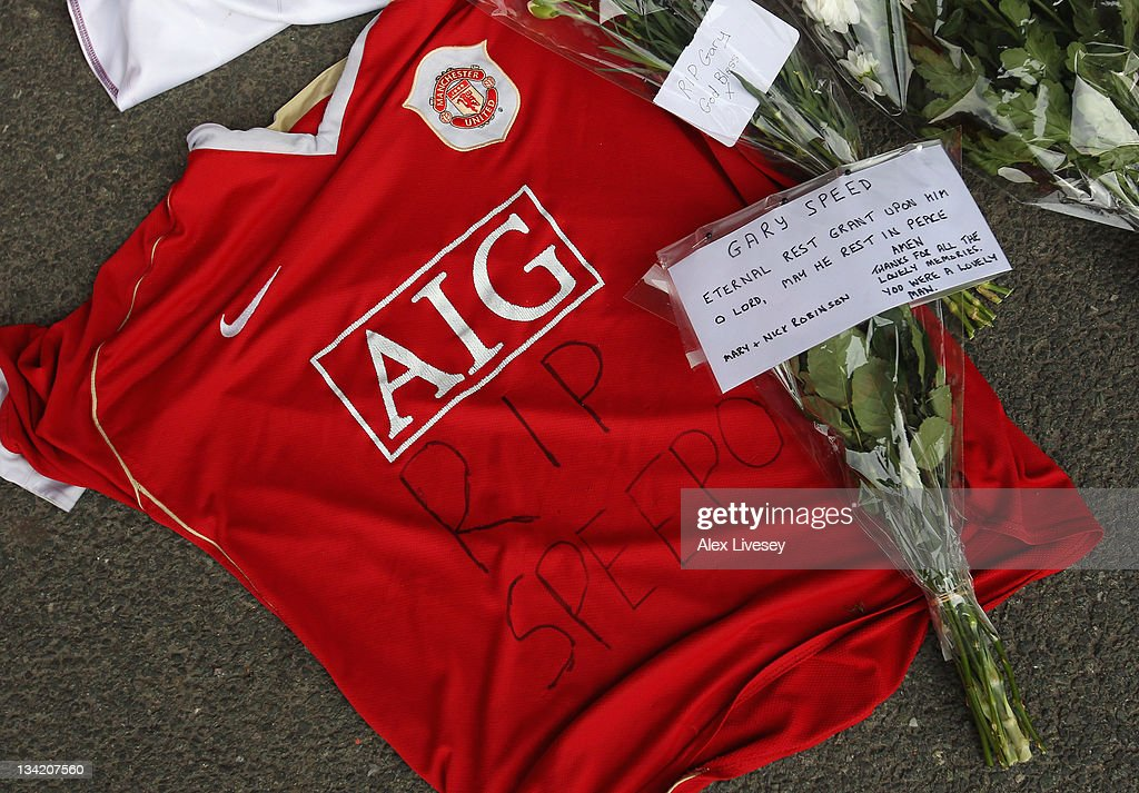 A Manchester United shirt is seen amongst tributes to footballer and ex Bolton Wanderers player Gary Speed outside the Reebok Stadium the home ground of Bolton Wanderers FC on November 28, 2011 in Bolton, United Kingdom.