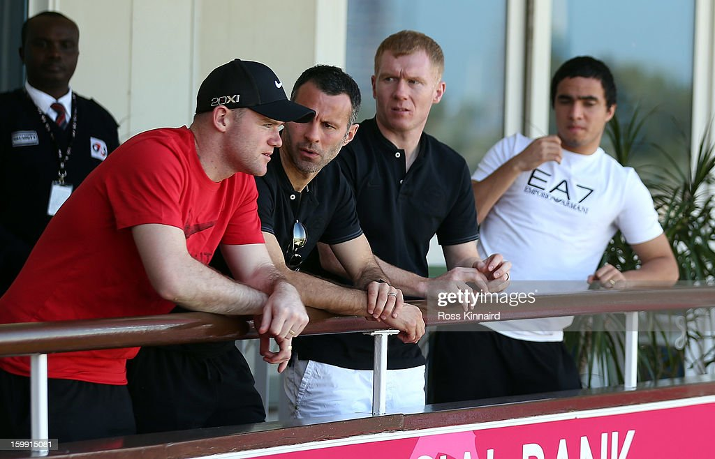 Manchester United stars Wayne Rooney, Rayn Giggs, Paul Scholes and Raphael watching the golf during the first round of the Commercial Bank Qatar Masters at The Doha Golf Club on January 23, 2013 in Doha, Qatar.