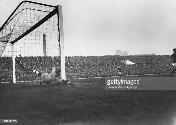 Manchester United stiker George Stacey scores a penalty during a league match against Manchester United at Old Trafford 4th October 1913 Manchester...