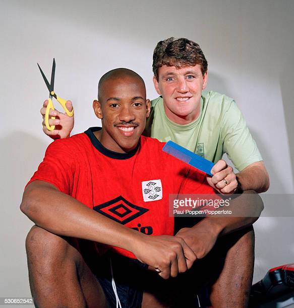 Manchester United striker Dion Dublin with Steve Bruce who is too late to give his teammate a haircut circa 1993