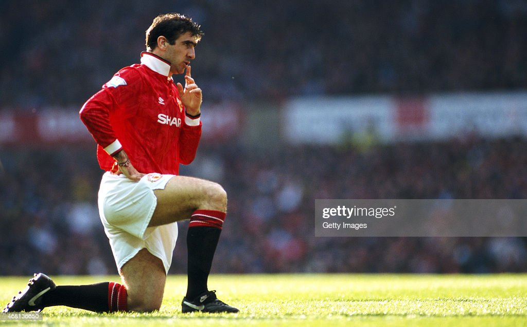 Manchester United striker <a gi-track='captionPersonalityLinkClicked' href=/galleries/search?phrase=Eric+Cantona&family=editorial&specificpeople=211325 ng-click='$event.stopPropagation()'>Eric Cantona</a> reacts during an FA Premier League match between Manchester United and Manchester City at Old Trafford on April 23, 1993 in Manchester, England, United won the game 2-0 with both goals scored by Cantona.