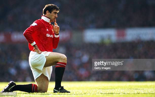 Manchester United striker Eric Cantona reacts during an FA Premier League match between Manchester United and Manchester City at Old Trafford on...