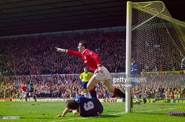Manchester United striker Eric Cantona wheels away after scoring the third goal in a 30 win over Chelsea in the Premier League at Old Trafford on...
