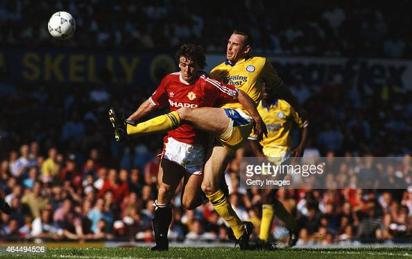 Manchester United striker Mark Hughes is challenged by Leeds defender John McClelland during a League Division One match at Old Trafford on August 31...